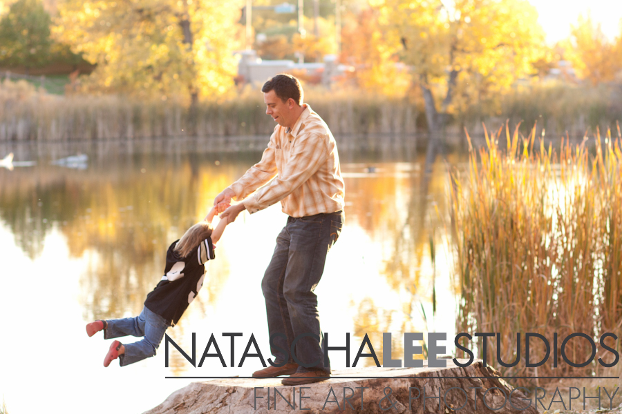 daddy spinning daughter - family photographer for Thornton, colorado Natascha Lee Studios
