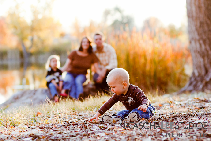 Baby boy with family in background - Thornton, Colorado Baby Photography