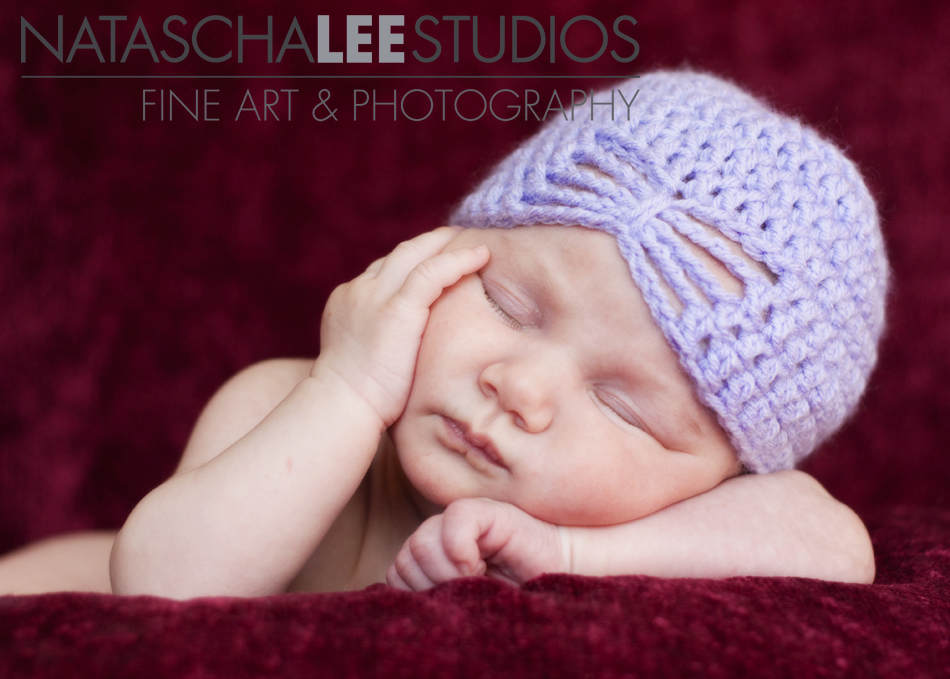 baby girl with knit hat | Vibrant baby photography by Natascha Lee Studios