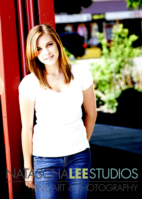 Artistic Outdoor Senior Photos in Boulder Colorado by Natascha Lee Studios - Girl leaning against a red wall