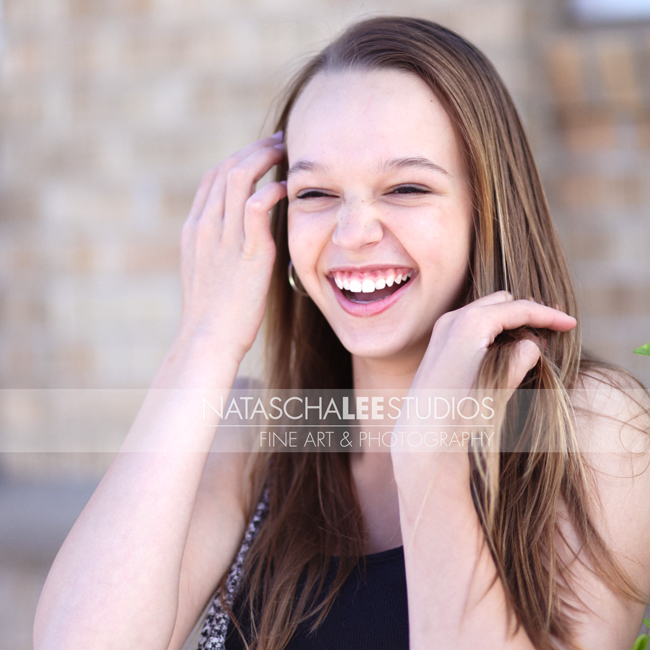 modeling portfolio images for Denver girl models -  with huge smile and beautiful long brown hair