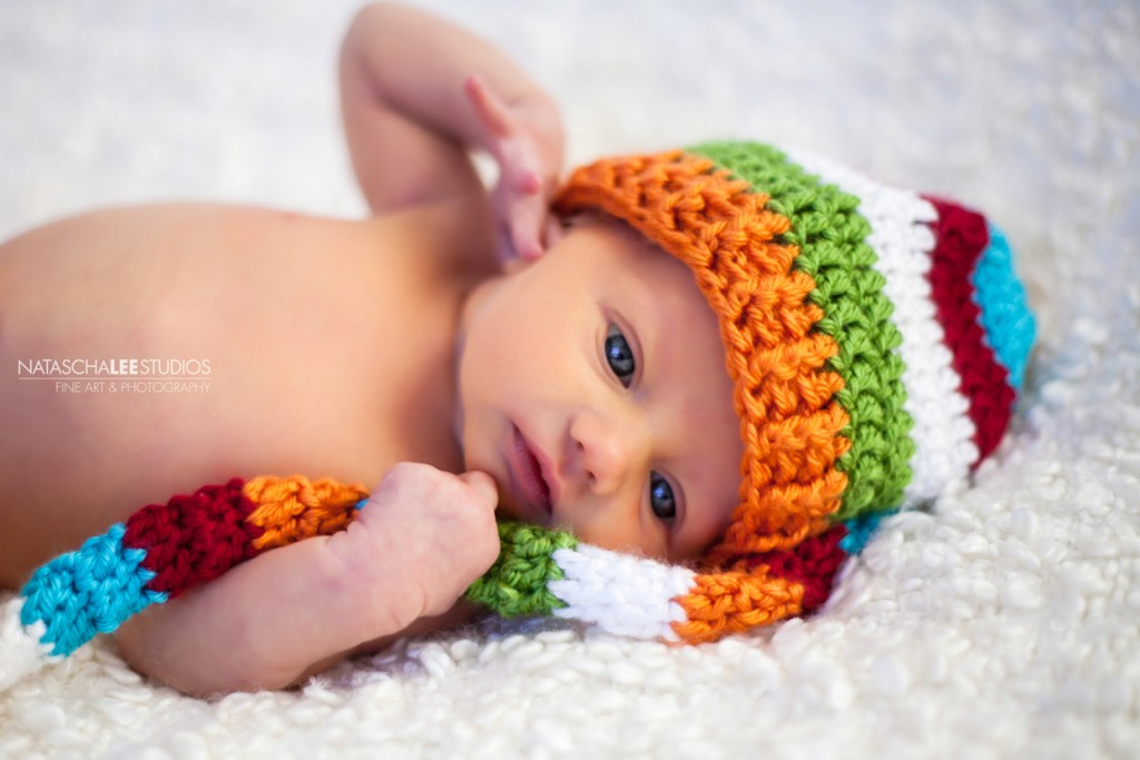 Denver Newborn baby with colorful knit hat - Baby Portraits